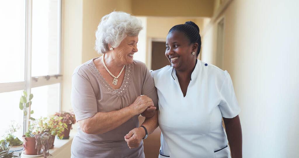 staff-and-elderly-smiling-together