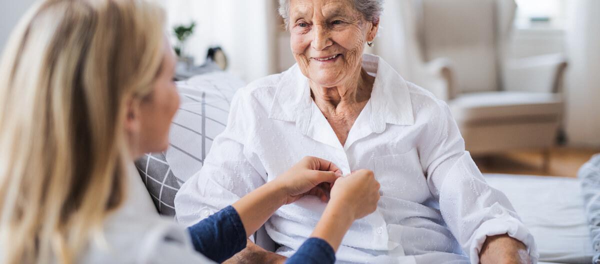 staff-helping-an-elderly-person-dress
